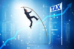 The businessman jumping over tax in tax evasion avoidance concept. Businessman jumping over tax in tax evasion avoidance concept Royalty Free Stock Photos