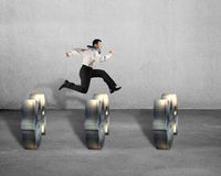Businessman jumping over USD symbols Stock Photography