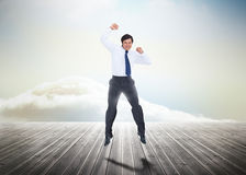 Businessman jumping over wooden boards Royalty Free Stock Images