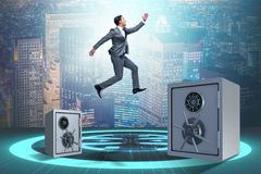 The businessman jumping from safes in business concept Royalty Free Stock Image