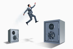 The businessman jumping from safes in business concept Royalty Free Stock Images