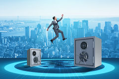 The businessman jumping from safes in business concept Stock Photography