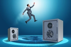 The businessman jumping from safes in business concept Royalty Free Stock Photos