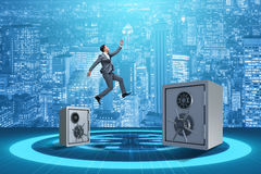 The businessman jumping from safes in business concept Royalty Free Stock Photography