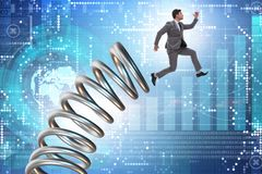 The businessman jumping from spring in promotion concept. Businessman jumping from spring in promotion concept Royalty Free Stock Photography