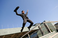Businessman jumping in the street. Young handsome businessman jumping in the street Stock Image