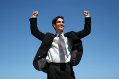 Businessman jumping for success Stock Images