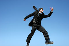 Businessman jumping for success Stock Photo