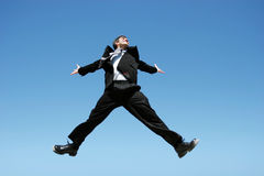 Businessman jumping for success Royalty Free Stock Photography