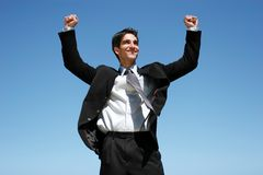 Businessman jumping for success Royalty Free Stock Photos