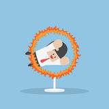 Businessman Jumping Through The Fire Hoop Stock Images