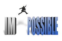 Businessman jumping to concrete word possible in white backgroun. Businessman jumping to possible from im, make it possible in white background Royalty Free Stock Photography