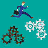 Businessman Jumping To New Cogwheels. Business Concept As A Businessman Is Highly Jumping Up From Rusty/Obsolete Cogwheels To New Ones. It Means Changing/ Stock Photos