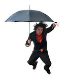 Businessman jumping with Umbrella Royalty Free Stock Photography