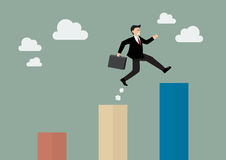 Businessman jumping up to a higher bar chart. Business concept Royalty Free Stock Image
