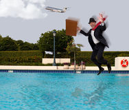 Businessman jumping. Into the water in a suit Royalty Free Stock Images