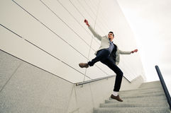 Businessman jumping, wearing jacket and shirt Royalty Free Stock Image