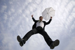Businessman jumps Stock Images