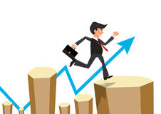 Businessman jumps the obstacle with arrow graph Stock Photo