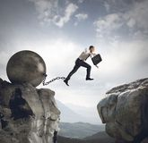Businessman jumps the obstacle Stock Image