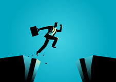 Businessman jumps over the ravine. Silhouette illustration of a businessman jumps over the ravine. Challenge, obstacle, optimism, determination in business Royalty Free Stock Photo
