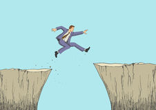 Businessman jumps from the ravine Stock Photo