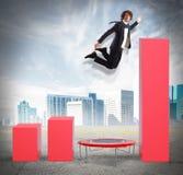 Businessman jumps to better statistics Stock Image