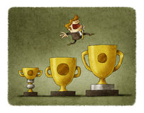 Businessman jumps from trophy to trophy, each time to one bigger Royalty Free Stock Photo