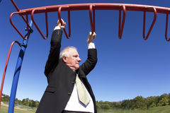 Businessman on Jungle Gym Royalty Free Stock Photos