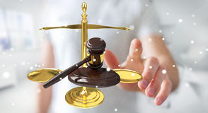 Businessman with justice hammer and weighing scales 3D rendering Stock Images