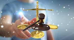 Businessman with justice hammer and weighing scales 3D rendering Stock Photos