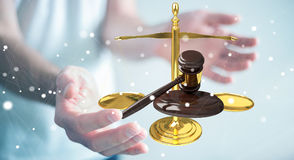 Businessman with justice hammer and weighing scales 3D rendering Royalty Free Stock Photos