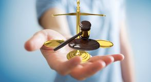 Businessman with justice hammer and weighing scales 3D rendering. Businessman on blurred background with justice hammer and weighing scales 3D rendering Stock Images