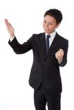 Businessman with a karate chop Stock Images