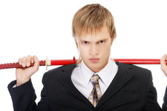 Businessman with katana Stock Images