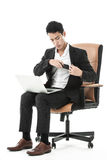 Businessman keep his phone in his suit Stock Image