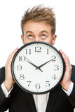 Businessman keeping clock Stock Photo