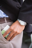 Businessman keeping currency in pocket Stock Photos