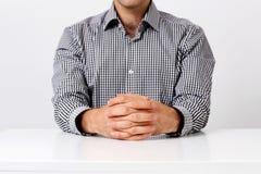 Businessman keeping fingers crossed Stock Images