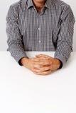 Businessman keeping fingers crossed Stock Photos