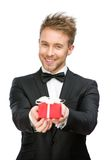 Businessman keeping gift box Royalty Free Stock Image