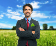 Businessman keeping a green leaf in his pocket Royalty Free Stock Images