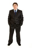 Businessman keeping his hands in trousers pockets Royalty Free Stock Photography