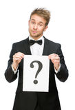Businessman keeping question mark Royalty Free Stock Photos