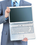 Businessman keeps the laptop. Royalty Free Stock Photos