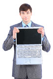 Businessman keeps the laptop. Stock Image