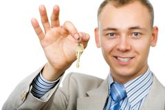 Businessman with a key Stock Photos