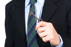 Businessman with the key. Office or home stock photography