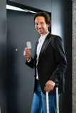 Businessman with key card for room door in hotel Royalty Free Stock Photo