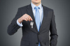 Businessman with key Stock Photography